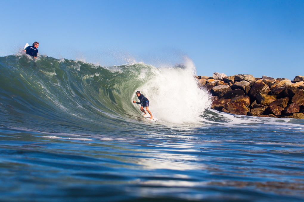 Mitch Parko adjusts for the looming section while Sheldon looks on