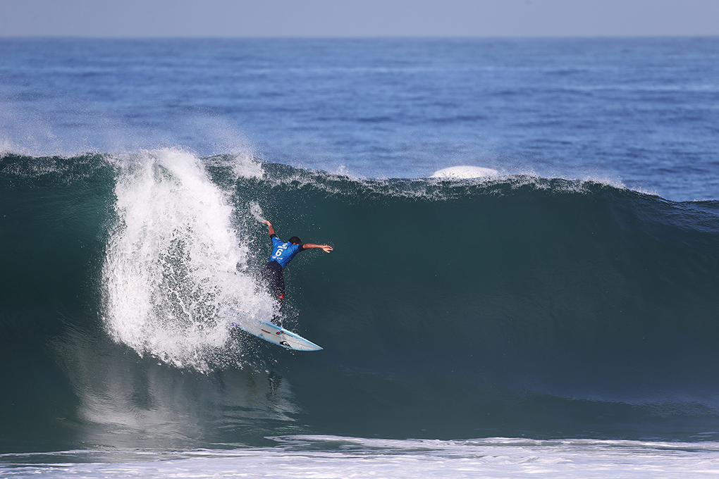 Wiggolly Dantas of Brasil (pictured) makes a critical drop during Round 1 at the Oi Rio Pro, winning his heat to advance into Round 3 in Barra De Tijuca, Rio, Brasil.