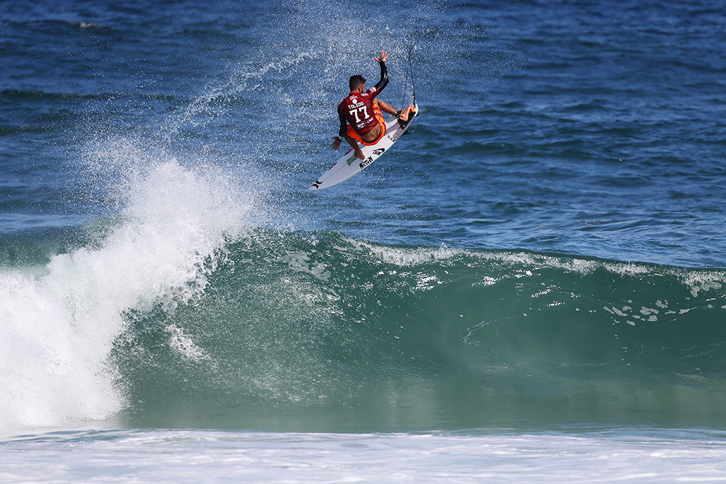 Filipe Toledo winning his Round 1 heat with a 9.70 aerial (out of ten) during Round 1 at the Oi Rio Pro in Barra De Tijuca, Rio, Brasil.